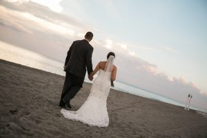 Bride and Groom walking Highland Beach