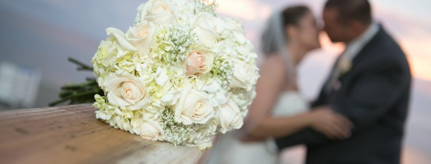 Bridal Bouquet and Bride and Groom in Distance